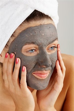 pressmaster - Beautiful woman with purifying facial mask keeping her palms by her face Stock Photo - Budget Royalty-Free & Subscription, Code: 400-04392078