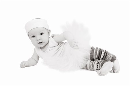 Baby girl wearing a ballet outfit and legwarmers Stock Photo - Budget Royalty-Free & Subscription, Code: 400-04392382