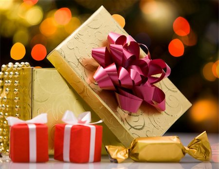 simsearch:400-05749231,k - Close-up of gift boxes and sweets on holiday background Stock Photo - Budget Royalty-Free & Subscription, Code: 400-04392576