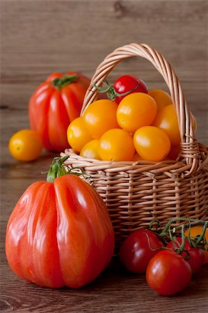 Organic tomatoes in wicker basket on a garden wooden table. Stock Photo - Budget Royalty-Free & Subscription, Code: 400-04393672