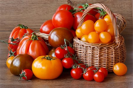 Organic multicolored tomatoes  on a garden wooden table. Stock Photo - Budget Royalty-Free & Subscription, Code: 400-04393898