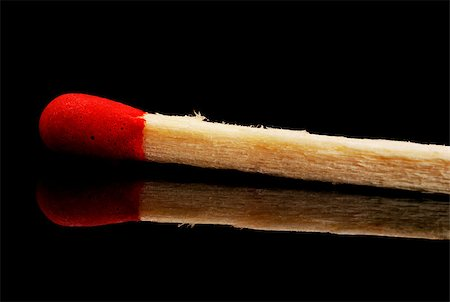 single matchstick with reflection over black background Stock Photo - Budget Royalty-Free & Subscription, Code: 400-04404991
