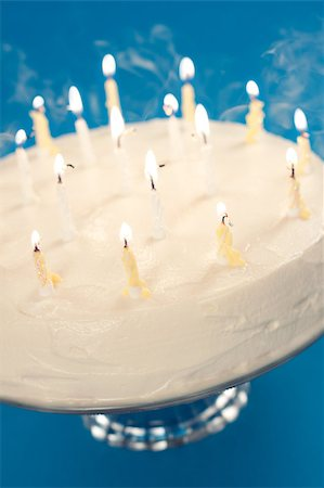 Birthday cake with smoke coming from blown out candles Stock Photo - Budget Royalty-Free & Subscription, Code: 400-04406251