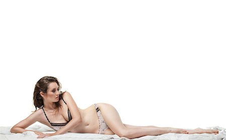 Sexy woman lying on the white bed in lingerie Stock Photo - Budget Royalty-Free & Subscription, Code: 400-04408050