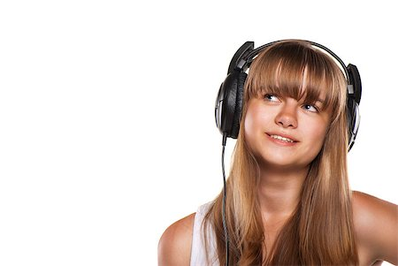 Lovely girl listening a music in headphones, white background Stock Photo - Budget Royalty-Free & Subscription, Code: 400-04408051