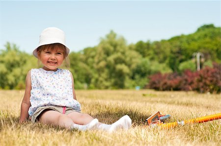 raysay (artist) - Little adorable girl posing with orange scooter in the park Stock Photo - Budget Royalty-Free & Subscription, Code: 400-04416788