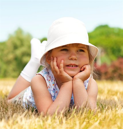 raysay (artist) - Little adorable girl posing in the park Stock Photo - Budget Royalty-Free & Subscription, Code: 400-04416789