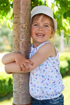 raysay (artist) - Little adorable girl posing by tree in the park Stock Photo - Budget Royalty-Free & Subscription, Code: 400-04416791