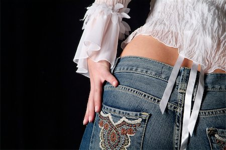the backside of a young woman in jeans Stock Photo - Budget Royalty-Free & Subscription, Code: 400-04425761