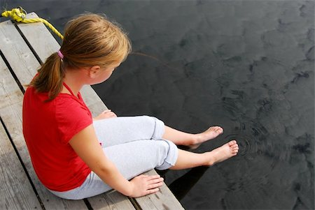 preteen girl feet - Young girl dipping feet in the lake from the edge of a wooden boat dock Stock Photo - Budget Royalty-Free & Subscription, Code: 400-04425993