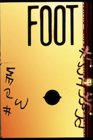 Piece of 35 mm motion film with the word 'foot' on it Stock Photo - Budget Royalty-Free & Subscription, Code: 400-04427246