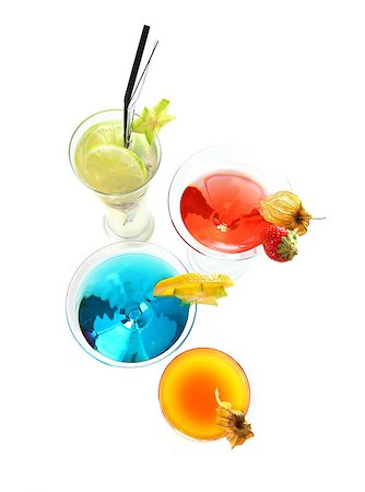 Different cocktails or longdrinks garnished with fruits Stock Photo - Budget Royalty-Free & Subscription, Code: 400-04422706