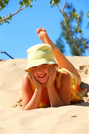 preteen girl feet - Young girl in yellow hat lying on top of a sand dune Stock Photo - Budget Royalty-Free & Subscription, Code: 400-04439093