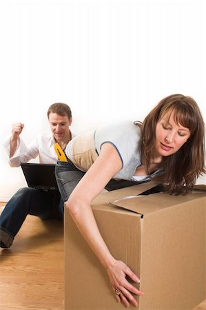 happy couple moving in new appartment opening boxes Stock Photo - Budget Royalty-Free & Subscription, Code: 400-04439337