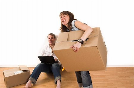 happy couple moving in new appartment opening boxes Stock Photo - Budget Royalty-Free & Subscription, Code: 400-04439338