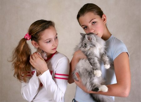 Two girls, one of them with a hamster, another with a cat Stock Photo - Budget Royalty-Free & Subscription, Code: 400-04430587