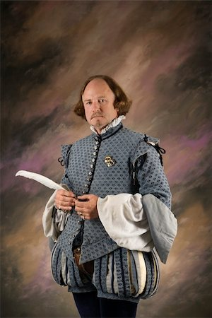 William Shakespeare in period clothing holding feather pen standing and looking at viewer. Stock Photo - Budget Royalty-Free & Subscription, Code: 400-04445185