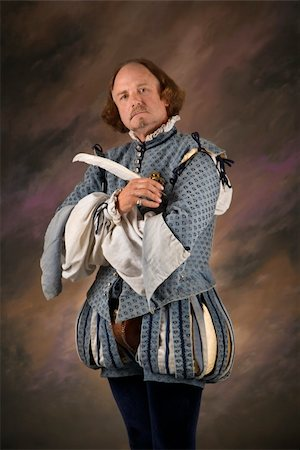 William Shakespeare in period clothing holding feather pen and looking at viewer. Stock Photo - Budget Royalty-Free & Subscription, Code: 400-04445186