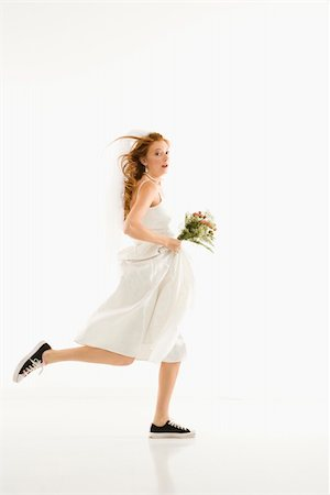 running away scared - Caucasian bride running and holding bouquet. Stock Photo - Budget Royalty-Free & Subscription, Code: 400-04445617