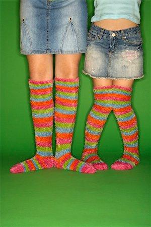 preteen girl feet - Caucasian female children wearing striped socks. Stock Photo - Budget Royalty-Free & Subscription, Code: 400-04448263