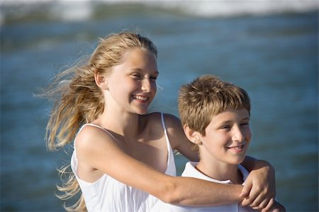 pre-teen boy models - Caucasian pre-teen girl with arms around pre-teen boy on beach. Stock Photo - Budget Royalty-Free & Subscription, Code: 400-04448403