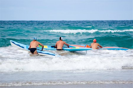 Iron men line up along the beach ready to start a race on their surf skis. Stock Photo - Budget Royalty-Free & Subscription, Code: 400-04441372