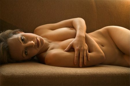 Pretty Caucasian nude woman lying on back on sofa. Stock Photo - Budget Royalty-Free & Subscription, Code: 400-04450437
