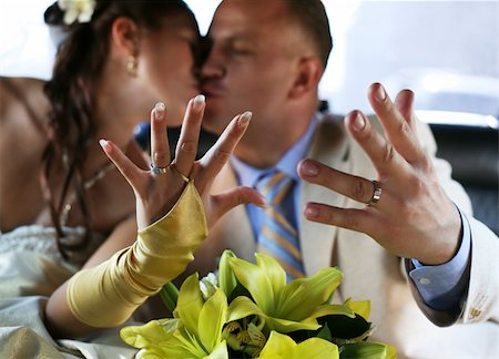 The groom and the bride kiss, showing wedding rings Stock Photo - Budget Royalty-Free & Subscription, Code: 400-04465768