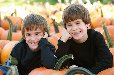 Boys Resting on a Pumpkin in the Pumpking Patch Stock Photo - Budget Royalty-Free & Subscription, Code: 400-04465793