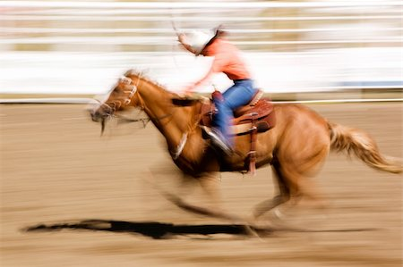A horse galloping fast with a female rider -  motion blur. Stock Photo - Budget Royalty-Free & Subscription, Code: 400-04466570