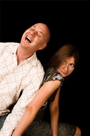 man laughing with woman with serious expression Stock Photo - Budget Royalty-Free & Subscription, Code: 400-04467680