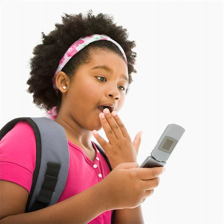 African American girl with backpack looking at cell phone with surprised expression. Stock Photo - Budget Royalty-Free & Subscription, Code: 400-04469053
