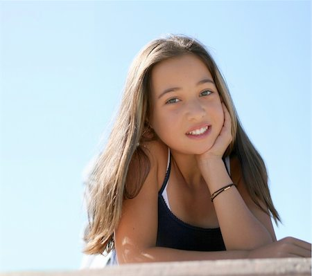 Asian teen girl against the sky Stock Photo - Budget Royalty-Free & Subscription, Code: 400-04469382