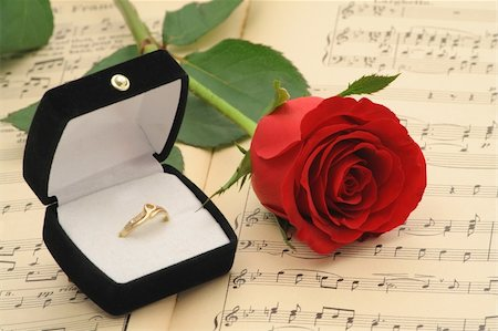 Propose to your love with style - engagement ring and rose on vintage sheet music Stock Photo - Budget Royalty-Free & Subscription, Code: 400-04460972