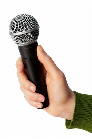 Holding a microphone Stock Photo - Budget Royalty-Free & Subscription, Code: 400-04474674