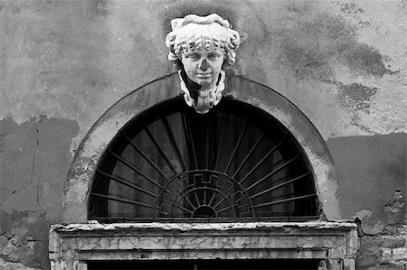 Bust above a worn doorway in Venice. Stock Photo - Budget Royalty-Free & Subscription, Code: 400-04477461