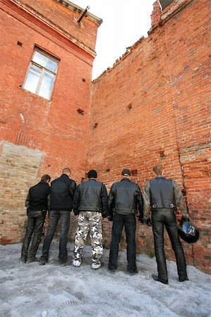 Four motorcycle racers at a brick wall with a window Stock Photo - Budget Royalty-Free & Subscription, Code: 400-04479454