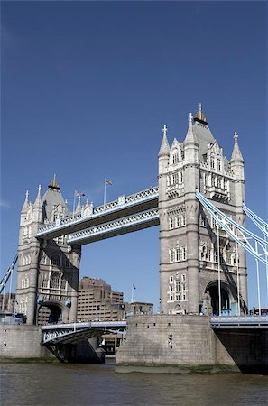 london tower bridge on the river thames one of London's most famous landmarks opened in 1894 and is easily recognised by its twin gothic towers london england uk europe taken in june 2006 from the south bank queens walk Stock Photo - Budget Royalty-Free & Subscription, Code: 400-04472706
