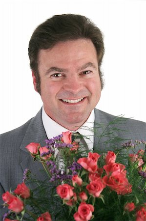 dozen roses - A headshot of a handsome businessman holding a bouquet of roses for his wife, girlfriend, secretary. Stock Photo - Budget Royalty-Free & Subscription, Code: 400-04486211