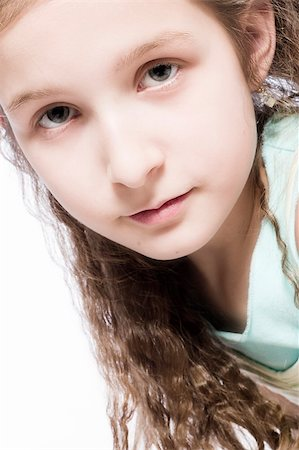 Studio portrait of a young girl looking concentrated Stock Photo - Budget Royalty-Free & Subscription, Code: 400-04486485
