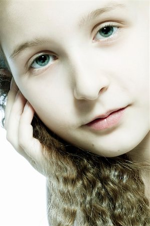Studio portrait of a young girl feeling pretty Stock Photo - Budget Royalty-Free & Subscription, Code: 400-04486486
