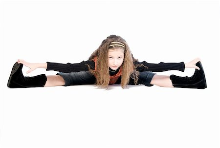 Studio portrait of a young girl doing gymnastics Stock Photo - Budget Royalty-Free & Subscription, Code: 400-04486488