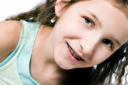 Studio portrait of a young girl looking happy Stock Photo - Budget Royalty-Free & Subscription, Code: 400-04486497