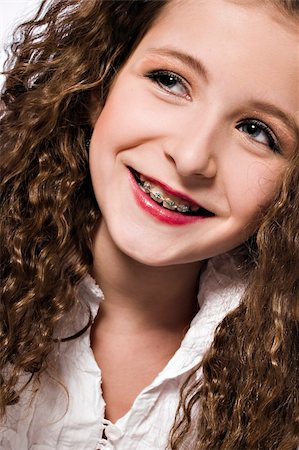 Studio portrait of a young girl with braces Stock Photo - Budget Royalty-Free & Subscription, Code: 400-04486498