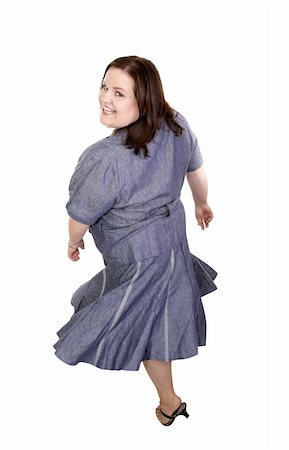 Beautiful plus sized model twirling around with her dress flaring.  Full body isolated on white. Stock Photo - Budget Royalty-Free & Subscription, Code: 400-04486840