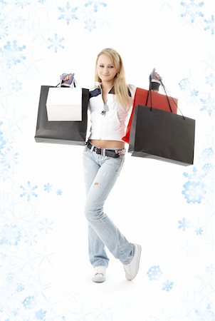 teenage girl with shopping bags and snowflakes Stock Photo - Budget Royalty-Free & Subscription, Code: 400-04489964