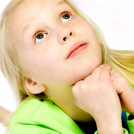 a model portrait in the studio of a child thinking Stock Photo - Budget Royalty-Free & Subscription, Code: 400-04483056