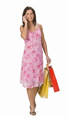 Young woman with shopping bags using a mobile phone. Stock Photo - Budget Royalty-Free & Subscription, Code: 400-04494456