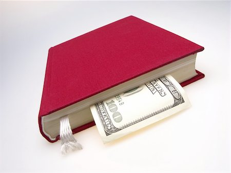 education loan - red book with enclosed by hundred dollar denomination on  light background Stock Photo - Budget Royalty-Free & Subscription, Code: 400-04495864
