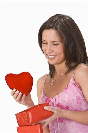 Woman taking out a plush heart from a gift box. Stock Photo - Budget Royalty-Free & Subscription, Code: 400-04498090